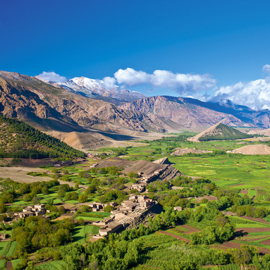 Landscape with cultivated fields and small settlement in Ait Bouguemez Valley, High Atlas Mountains, Morocco, Africa --- Image by © Wigbert Röth/imagebroker/Corbis